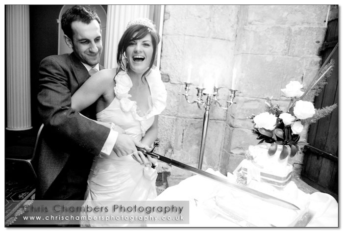 Cutting the wedding cake - Hazlewood Castle near York, Yorkshire castle wedding venue.