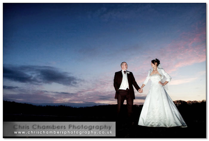 The bride and groom at sunset at Walton Hall Wakefield