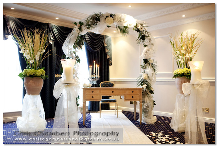 The ceremony room at Walton hall Wakefield. Floral arrangement from West End Florists in Wakefield