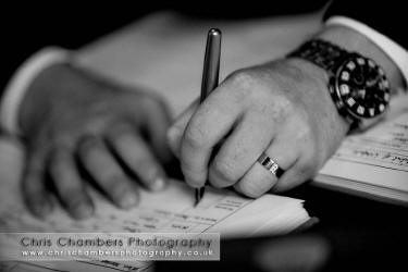 Signing the register wedding photography