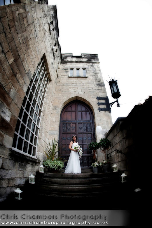 Hazlewood Castle wedding - the bride on the steps at Hazlewood Castle