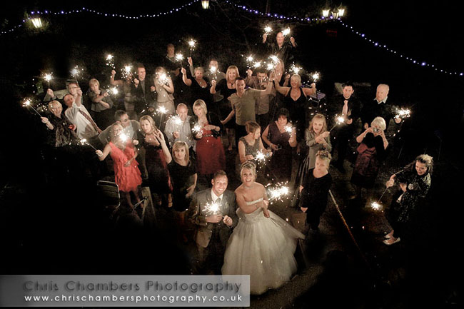 Wedding guests hold their sparklers high just after midnight. Happy New Year